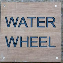 water wheel wall sign
